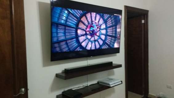 Instalación de pantallas de televisión . smart tv , curve y led